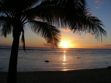 Sunset over the Cook Islands photo