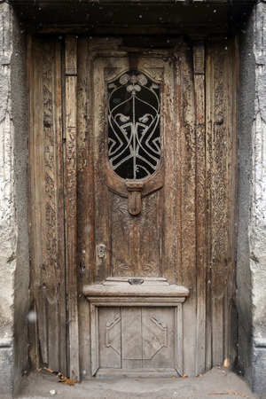 facade of an old building door with forged iron in Tbilisi Old town