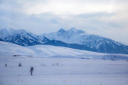 Beautiful snow mountain range landscape in Kyrgyzstan Stock Photo