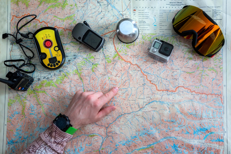 Tourism planning and equipment needed for the ride on map with backcountry equipment