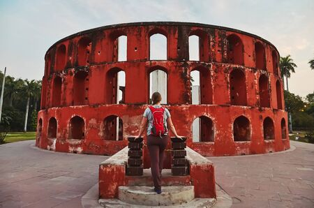Girl tourist standing near Historic observatory, Jantar Mantar, New Delhi, India