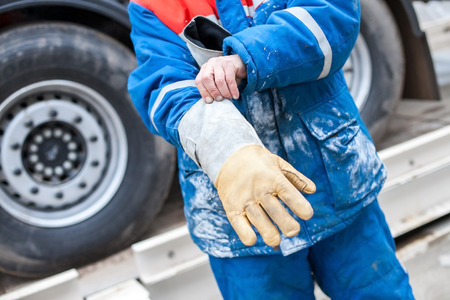 wear: Worker wear gloves for protection. Stock Photo