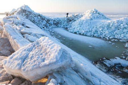 sneaks: Man sneaks past the frozen sea ice hummocks Stock Photo