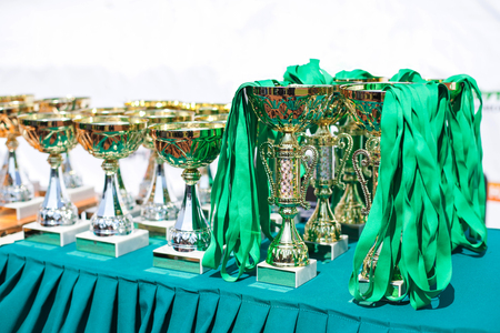 the victorious: Victorious cups in sports meets. Cups of winners. Trophy cups. Stock Photo