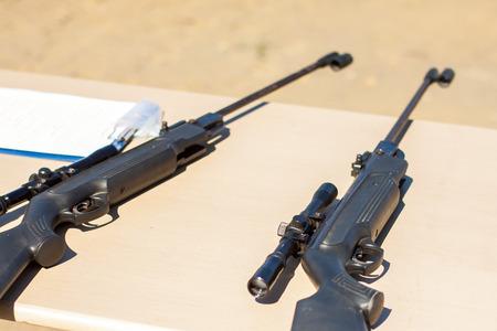 Small-bore pneumatic weapon. The small-bore pneumatic weapon on a table. Small-bore air rifle.