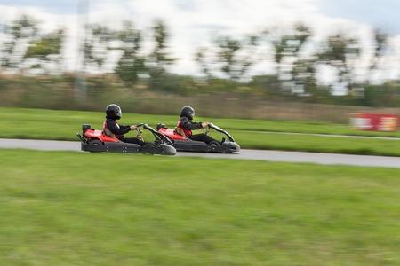 carting: Super kart racing team. The racer on carting. Two Races on cartings. Races on a cross-country terrain. Cars races. Races on long exposure.