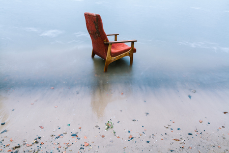 upholstered: vintage chair on the seashore.