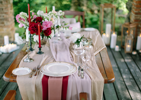Festive table setting. Wedding decor. Table setting in classic style. Pastel table decor.