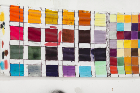 schemes: color palette. the table of shades of paints on fabric. color schemes at art school. range of colors. Stock Photo