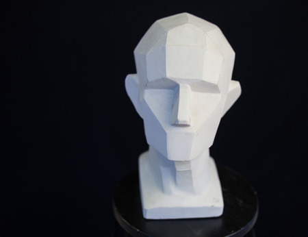 poems: plaster bust of the person on a black background in style a cubism. concept of the person. empty space for the text. fullface of the person. model of the head of the human. Stock Photo