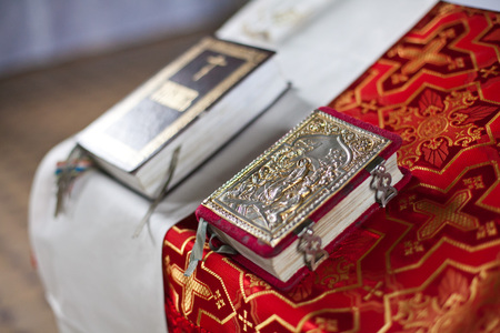 the holy christian bible on a table of the priest close up. concept of faith in god, preparation for a baptism in church. Christianity concept.