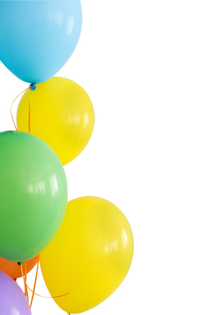 inflated: holiday, decorations for birthday, joy concept - brightly colored inflated balloons on ribbons, five colors, blue, yellow, green, orange, violet, copy space, vetical, isolated on white background.
