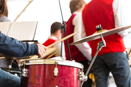 drum kit, jazz band music concept - closeup on hand of musician playing with stick on percussion instrument and ride cymbal, orchestra rehearsal before concert performance, selective focus Stok Fotoğraf