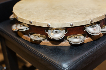 drumhead or drum skin, percussion instrument concept - beautiful closeup on orchestral tambourine, ensembles and jazz concerts of classical music, turkish folk, greek, italian, samba, pop and rock Stock Photo