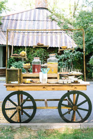 healthy llifestyle: healthy llifestyle, vegetarianism, food concept. amount of various marvelous and healthy treats with drinks in the customer of grocery shop made in the vintage style with decorative wheels Stock Photo