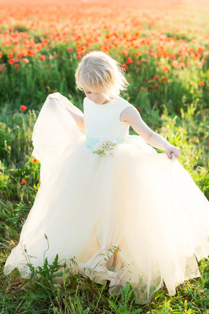 girl model, poppies, fashion, summer nature concept - pretty blonde girl dance in the sunny field of poppies, she is in white wedding dress with beautiful blue belt decorated with flowers