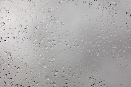 weather, background, uniqueness concept. close up of the window, there are lots of rain drops on it, they are like snowflakes very special, each has its own size and form Stock Photo