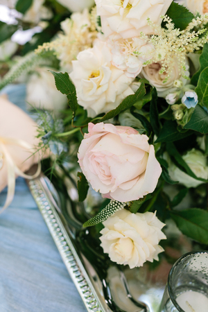 nature, flower arrangement, marriage concept. in the perfect bridal bouquet there are big buds of roses in different shades and forms and also blossoms of small blue unbloomed flowers