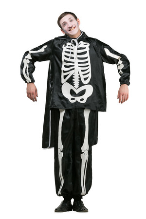 halloween, holidays, all saints day concept. on white background isolated cute funny guy is dressed up like a skeleton and has special make up, he is making excellent pantomime show Stock Photo
