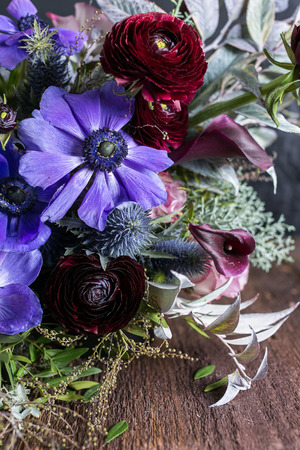 nature, tenderness, wedding decoration. absolutely different flowers are composing one wonderful unique bouquet, lilac anemons by pink lilies and persian buttercups