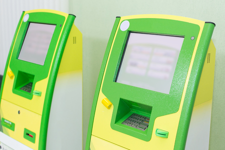 business, money, electronics concept. there are few new electronic terminals of green and yellow colours, very handy tool for safekeeping your resources and operates with them Stock Photo