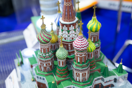 handcrafting, art, sightseeing concept. the smallest architectural model of cathedral of vasily the blessed that is placed in moscow in red square, it is made of colorful cardboard