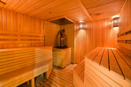 interior, spa procedure, beauty cincept, there is lovele decorated space for taking steam buth in comfort and having rest with friends on wooden benches