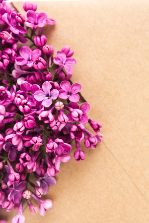 Sprigs of Lilac in postal envelope on wooden background. copy space.spring mood. international womens day. the freshness of flowers.The inscription on the letter -happy Фото со стока