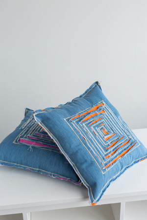 art, interior, style concept. there is wonderful handmaden pillows that was sewed in the traditional way, few patches are stitched together, some of them are jeans ans some of them are cotton Stock Photo
