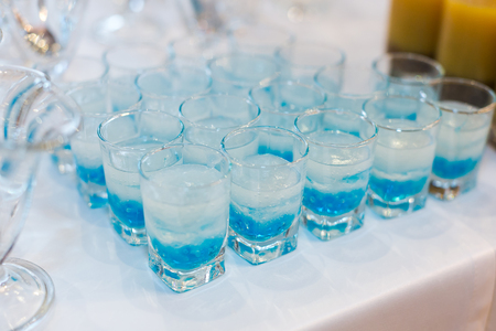glowing drinks of the fluorescent bar, colorful cocktails with molecular caviar from blue syrups, gels of strong mens drinks.