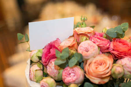 present concept. close up of gorgeous roses and peonies collected in charming bouquet with clean card special for congratulation Reklamní fotografie