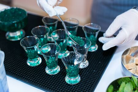 making a green caviar shot at molecular bar drink.