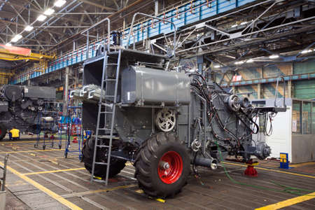 ROSTOV-ON-DON, RUSSIA - MARCH 2008: Factory for the production of agricultural machinery. Side view if unit in assembling process on line for the production of tractors, combines and machines for industrial use. Editorial