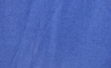 Navy blue fabric with pleats. Abstract background with empty space for text. Plain textile structure. Stock Photo