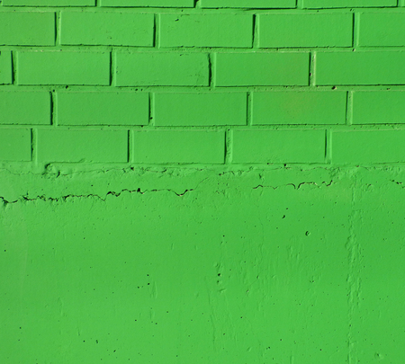 Bright green brick wall and a plaster texture. Closeup view of solid surface with regular structure. Industrial or construction background with place for text Stock Photo