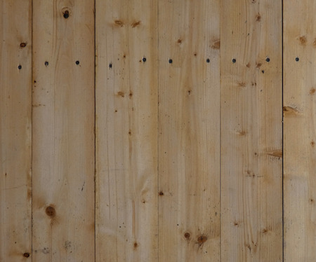 New wooden wall. Big fresh boards with knots. Natural