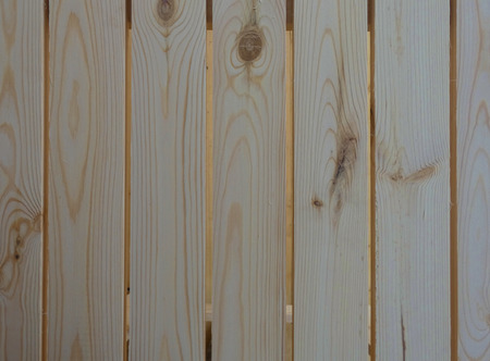 New wooden wall. Big fresh boards with knots. Stock Photo