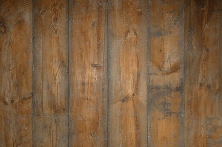 Old wooden floor. Big aged boards with knots.