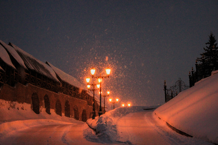 Winter road and lampposts, night landscape. Stock Photo
