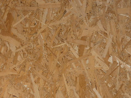 Pressed wooden panel, texture of oriented strand board Stock Photo