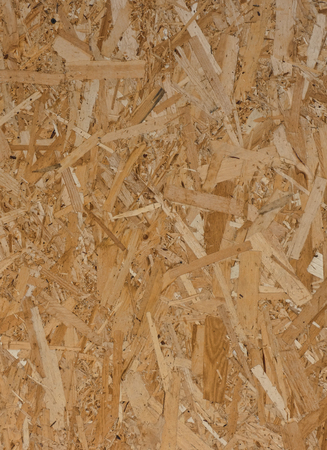 Pressed wooden panel, texture of oriented strand board Фото со стока