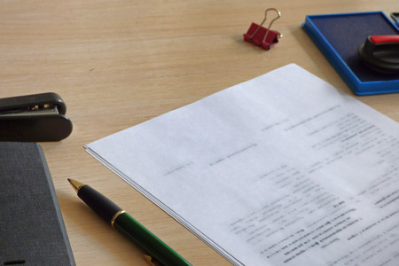 Office table with papers ready to sign. Pen, stamp and documents. Reklamní fotografie