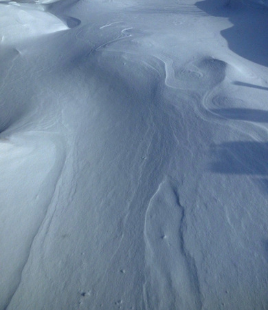 Snow texture, white surface with curves and shadows. Natural abstract background. Stok Fotoğraf