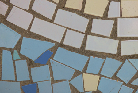 Aged mosaic surface - closeup view. Colored ceramic tiles, pieces of glass on plain surface. Real geometric background. Stok Fotoğraf