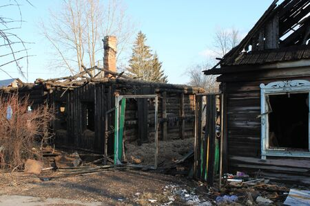 After fire - burnt house. Black burned wooden walls