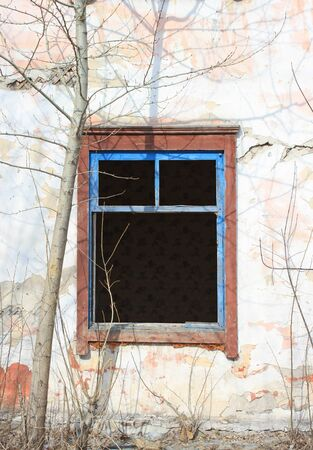 Old abandoned building - empty windows with broken glasses. Imagens
