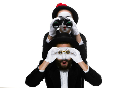 Two memes as business people  looking through binoculars isolated on white background. concept of search and surprise photo