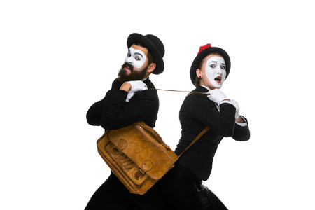 memes: Two memes as business man and woman fighting over briefcase isolated on white background.