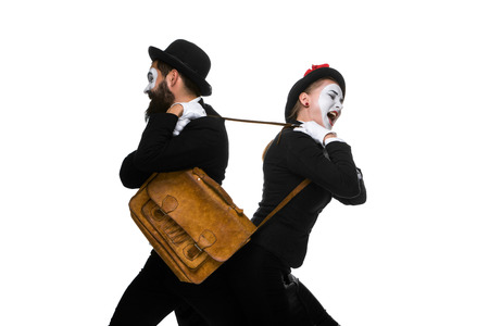 Two memes as business man and woman fighting over briefcase isolated on white background. photo