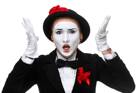 resent: Portrait of the angry and resent woman as mime with open mouth isolated on white background.